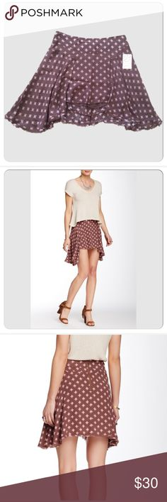 """🆕Free people skirt. Size 10 Super cute Free people printed skirt. Back zip closure, allover print, handkerchief hem, Approx. 15"""" shortest length, 21"""" longest length, waist 16,5"""". Size 10.  Fiber Content: Shell: 50% viscose, 50% rayon Lining 100% rayon.  Brand new with tag.  There is tiny unnoticeable run. (Last picture) New Must-have skirt Free People Skirts Mini"""