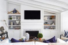 Chic living room features a sloped ceiling over a flat screen tv and white denti. Chic living room features a sloped ceiling over a flat screen tv and white dentil fireplace mantle Built In Around Fireplace, Fireplace Built Ins, Shiplap Fireplace, Fireplace Remodel, Fireplace Bookshelves, Fireplace Design, Media Fireplace, Fireplace Stone, Fireplace Cover