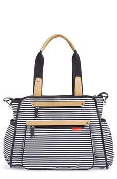This black and white striped Grand Central Tote Bag from @skiphopnyc is super modern, chic and holds everything you need for baby! #pishposhbaby #blackandwhite