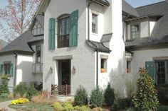 Exterior Paint Colors - You want a fresh new look for exterior of your home? Get inspired for your next exterior painting project with our color gallery. All About Best Home Exterior Paint Color Ideas White Brick Houses, Dark Trim, White Wash Brick, Tudor House, Tudor Cottage, French Style Homes, Exterior Paint Colors, Parade Of Homes, Metal Roof