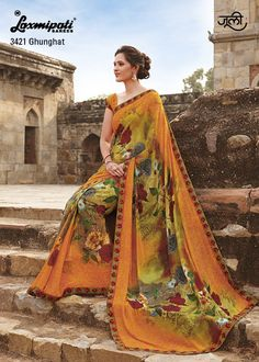 This orange floral printed saree with smoke effect georgette blouse will surely change your appearance.