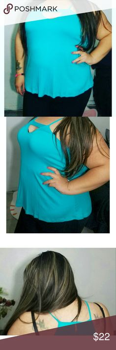 Turquoise top Brand new Very flattering and definitely stands out! Tops Blouses