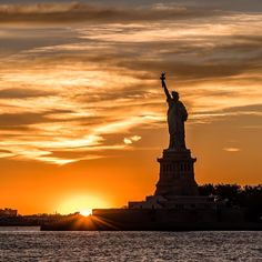 View of Statue of Liberty at sunset by @javanng #newyorkcityfeelings #nyc #newyork