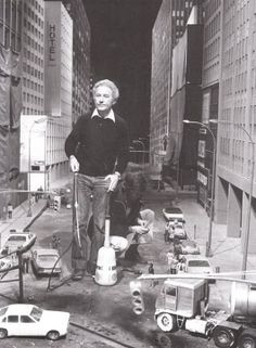 "Derek Meddings during the filming of ""Superman 2"" on the miniature Metropolis set."