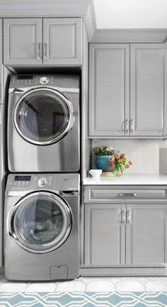stacked washer and dryer with counter and upper cabinet or a  rod for hanging clothes.