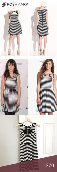 Betsey Johnson black and white striped dress Never been worn, with tags, Betsey Johnson size 2 black and white striped dress. In perfect condition! The dress features an adorable bow-like neckline with a keyhole type opening below. 95% Rayon, 5% Spandex. Fits as expected. Betsey Johnson Dresses Mini