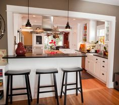 Traditional Kitchen with Kitchen island, Crown molding, U-shaped, European Cabinets, Wood counters, Breakfast bar