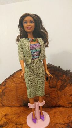 Barbie is wearing a light blue dress with a off the shoulder neckline. A beautiful bead headband is made with glass blue pearl. She has matching shoes to go a long with outfit. Barbie Beach doll is in