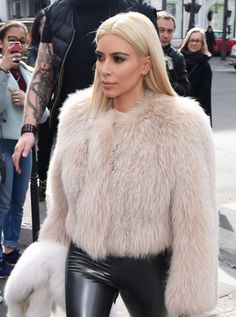 kim kardashian is loving very chic in leather and fur