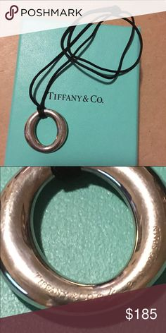 Tiffany Sevillana Necklace Authentic, silver with original silk cord, box included very good condition Tiffany & Co. Jewelry Necklaces