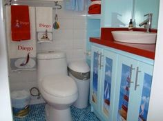 """""""Lighthouse/Coastal"""" cool kids themed Bathroom """"Bright Colors and Stenciled Cabinets give this kids bathroom a very fun coastal look!"""" """"Matching towels & accessories make this bathroom very fun & cool, indeed!"""""""