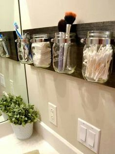barnwood with mason jar storage - would be good for kitchen utensils