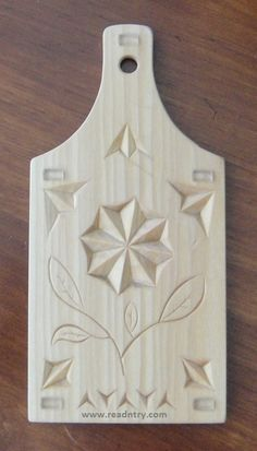 Chip carved cutting board. Large, shallow chips...