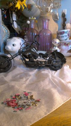 Check out this item in my Etsy shop https://www.etsy.com/listing/476080840/metal-motorcycle-sculpture