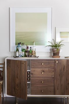 Mid-Century buffet + bar area - turn Ikea sideboard into bar, paint outside white.