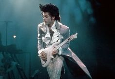 "Prince and 'Cloud'. Made famous in the movie Purple Rain, Prince's voluptuously curvy custom-built ""Cloud"" guitar was designed by a local Minneapolis luthier and reproduced by Schecter guitars. Schecter Guitars, Famous Guitars, Dearly Beloved, Roger Nelson, Prince Rogers Nelson, Purple Reign, My Prince, My Guy, Record Producer"