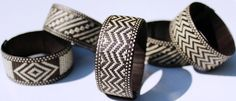 Handcrafted bracelets made by Zenú Indian artisans of the Caribbean region of present-day Colombia, South America.  They consist of black and white caña flecha (arrow cane) fiber strips woven over a blank.  The band width is approximately one inch.