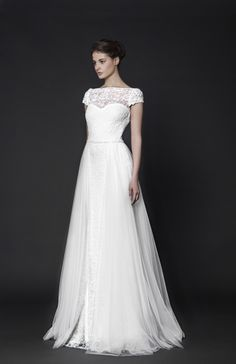 Off-White Lace gown with Tulle overskirt featuring embroidered cap sleeves and a belted waist.