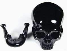 """You are looking at a Black Obsidian skull. The skull is 5.3 inches long, from front to back. Obsidian is actually natural glass that is formed when hot lava is submerged in water. This is a strong grounding stone and is known as """"the protector"""". It is said to """"mirror one's soul. This stone brings about objectivity, dis-attachment and is grounding. It reduces fantasy and escapism. Absorbs and dissolves anger, criticism, fear, and therefore is protective. This unusual black stone absorbs darkness Black Skulls, Crystal Skull, Light In The Dark, Crystal Healing, Carving, Crystals, Macabre, Lava, Darkness"""