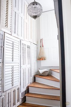 Makeover that old staircase to give it a beautiful new look. Tips on how to make a white and wood staircase with before and afters images.