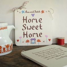 a personalised home sweet home board that I painted for a customer with a long hand painted message on the reverse (this is a picture of two - showing a front and the long message reverse of the other one) http://www.notonthehighstreet.com/moobaacluck/product/home-sweet-home-sign