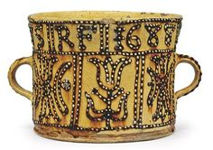 SLIPWARE        A STAFFORDSHIRE DATED TWO-HANDLED CUP    1688