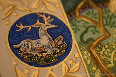 Detail of heraldic badge from the border of the illuminated painting The Lady and the Swan by British artist and illuminator Andrew Stewart Jamieson. The roundel is 3cms high.