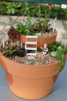 a 2-level fairy garden using clay pots