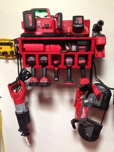 This is the handcrafted Garage Power Tool Rack with a Shelf. This is a great space saver for you garage. The cutouts allow for 5 power tools to be hung from the bottom. The shelf is a great place for your drill bits, drill attachments, screws, etc. The top shelf acts for a perfect charging station for the power tool batteries! This rack will free up space in your garage and will be the topic of conversation next time the guys/gals are over!  We also are able to paint/stain these rac...