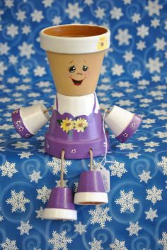 Check out this item in my Etsy shop https://www.etsy.com/listing/211171530/flower-pot-people-with-a-purlpe-and