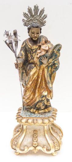 Imagem de madeira policromada, São José. Bahia, século XIX. Alt. 39cm. Não vendida. Preço base 3.000,00