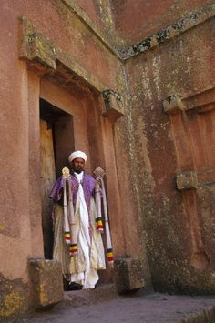 Africa | Priest with Cross. Cross Church (church cared into rock ~ Unesco World Heritage Site), Lalibela, Ethiopia | © Wolfgang Kaehler