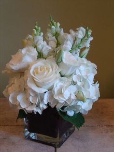 All white flowers in glass vase - could use any color ribbon or liner. The creative possibilities are endless.