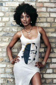 A dress adorned with cowrie shells, and oh so hot! I'll take that and the hair do please.