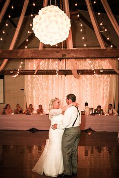 Dancing bride and groom with twinkle light backdrop at barn wedding close to Salem Oregon