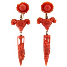 Victorian Archaeological Revival Carved Coral Pendant Earrings | From a unique collection of vintage dangle earrings at https://www.1stdibs.com/jewelry/earrings/dangle-earrings/