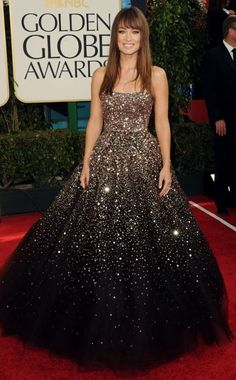 OLIVIA WILDE  The star turned heads in a chocolate brown princess dress by Marchesa embellished with dazzling gold sequins at the 2011 Golden Globe awards. She smartly styled her hair in a casual down 'do to balance out her dramatic dress.
