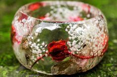 Resin Bangle with pink roses from the famous Bulgarian rose valley. Bulgaria produces the best rose oil in the world, and our jewelry is made from these Bulgarian rose oil roses.We use a secret technique to preserve the color of the rose, so it doesnt vanish.There are Baby Breath white flowers mixed with the roses.  Please keep in mind the size of the bangle!!!!! Bangle Size : M inner diameter – 6.5cm/2.56inch hight - 4.7cm/1.85inches  You will get exactly the same piece that you s...