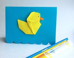 Items similar to Greeting card - Yellow duckling origami card on a cyan blue background. Perfect for a baby shower or birthday, duck in a bath or water waves on Etsy Origami Cards, Cyan Blue, White Envelopes, Blue Backgrounds, Something To Do, Greeting Cards, Baby Shower, Etsy, Yellow