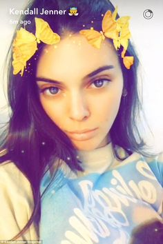Butterfly beauty: Meanwhile her sister Kendall was getting stuck into Snapchat, joking around with various filters