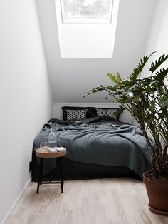 tiny bedroom with slanted ceiling | @bingbangnyc