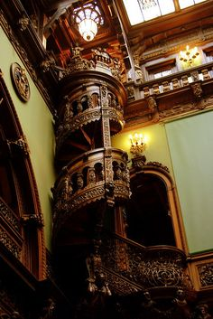 Wooden spiral staircase inside the Peles Castle, Romania (by Eduard Wichner).