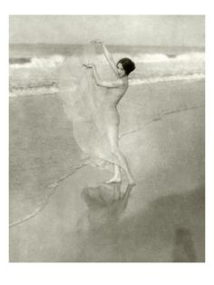 Vanity Fair - January 1924. Dancer Margaret Severn was an international star in the 1920s and '30s, famous for her pioneering mask dances. Here, she is captured on a beach in a diaphanous dress. This photograph, by Arnold Genthe, appeared in the January 1924 Vanity Fair.