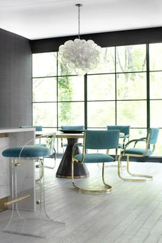 The dining area is located by the window, and the upholstered gilded chairs echo with the lucite ones Turquoise Dining Chairs, Contemporary Dining Chairs, Contemporary Decor, Atlanta Homes, Residential Interior Design, Decoration, House Design, Design Room, Set Design