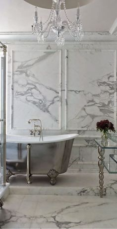 so many things no here, marble, chandelier, free standing tub, chrome decorative table legs