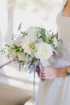 White dahlia bridal bouquet tied with a pretty striped ribbon. Photo: Stacy Able / Floral Design: Anna Held