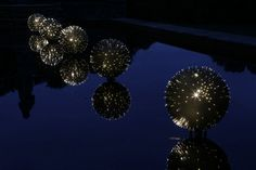 When we think of large-scale light installations, Bruce Munro instantly comes to mind. From light bulb gardens to large waterlilies made out of recycled CD Street Installation, Light Installation, Garden Bulbs, Modern Metropolis, Pretty Lights, Light Project, Water Lilies, Public Art, Artist Art
