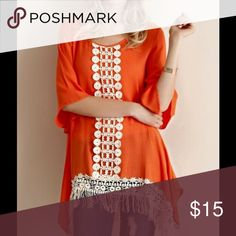 Orange top with fringe detail This listing is for a orange top with fringe detailing. The material is 100% rayon Entro Tops