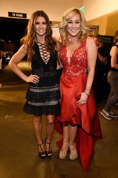 Race car driver Danica Patrick and singer Kellie Pickler pose backstage at the 2016 CMT Music awards at the Bridgestone Arena on June 8 2016 in...