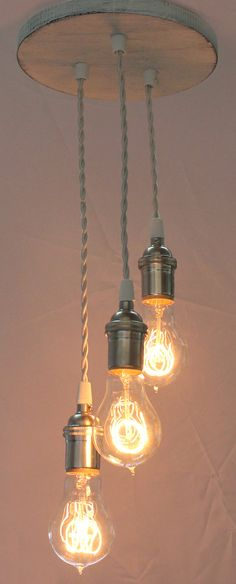 Antique White Pendant Light with Victorian style Edison bulbs made from reclaimed wood. $225.00, via Etsy.